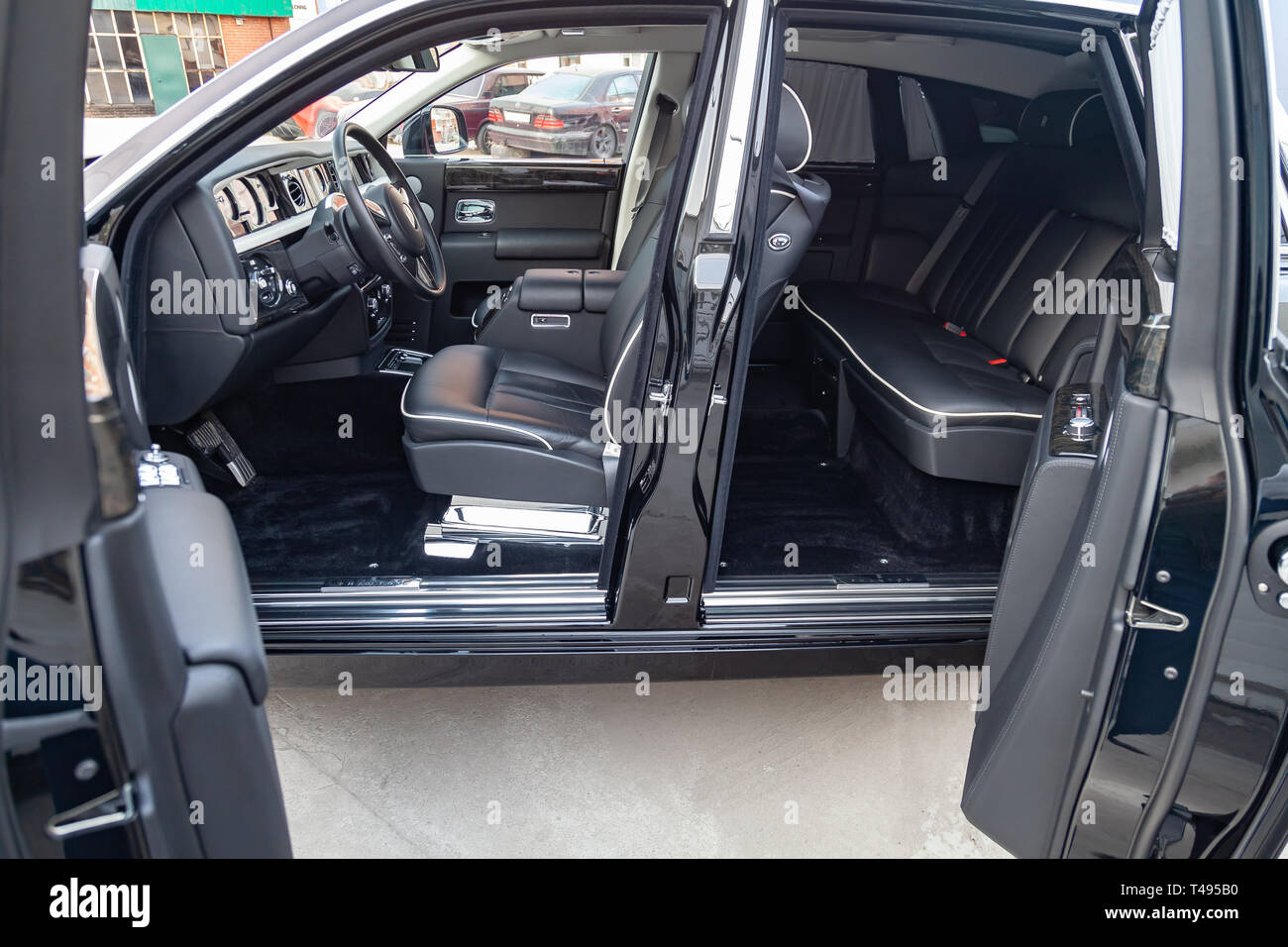 Novosibirsk Russia 04 11 2019 Interior View Of New A Very Expensive Rolls Royce Phantom Car A Long Black Limousine With Opened Doors Dashboard Stock Photo Alamy