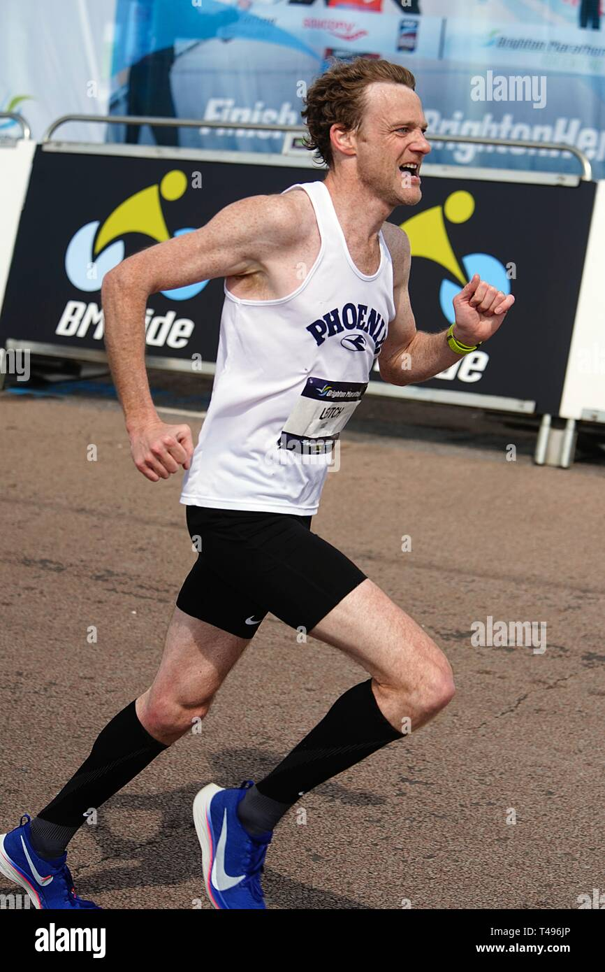 Ian Leitch running in the tenth Brighton Marathon - Stock Image