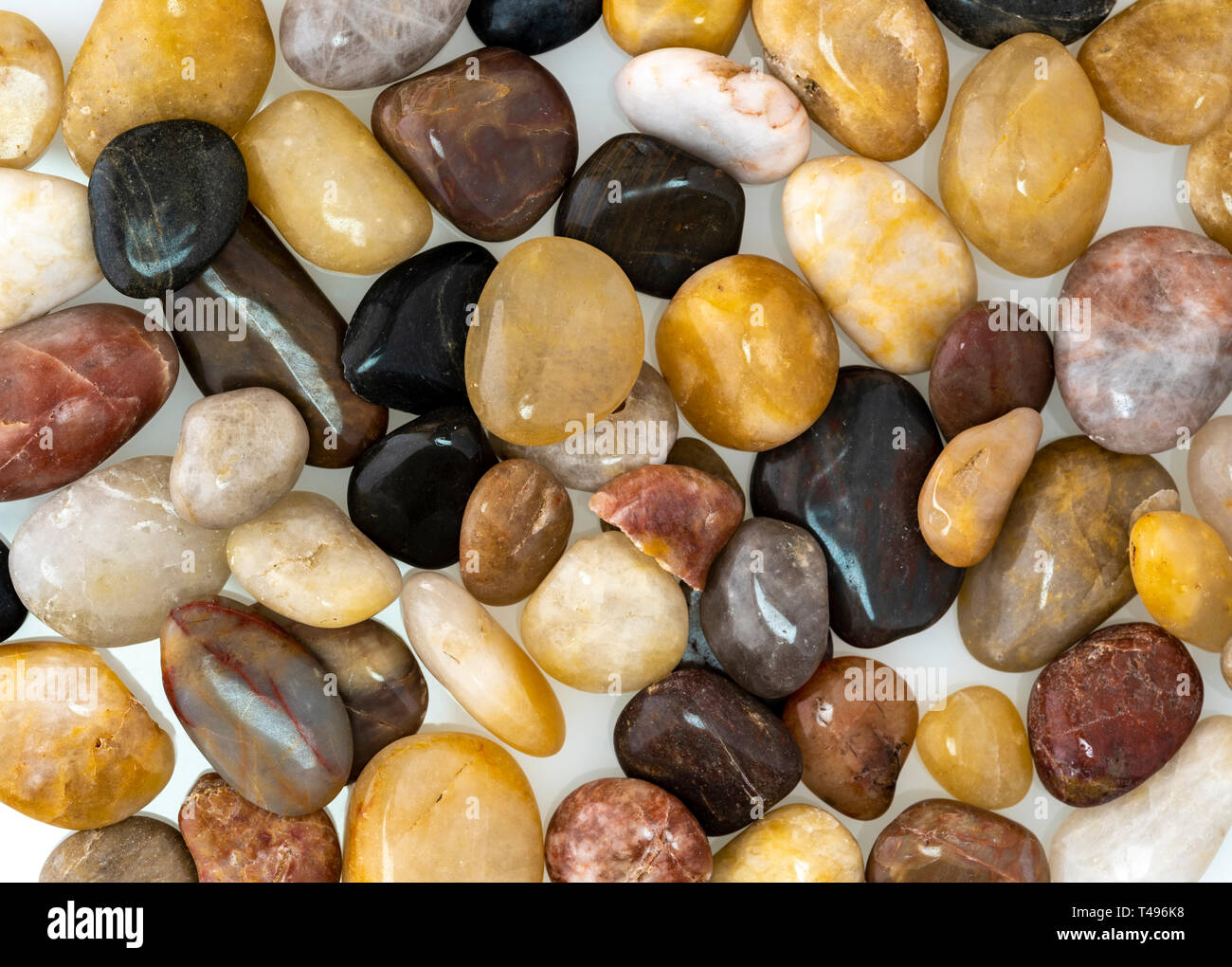 Abstract background of ornamental polished stones. - Stock Image