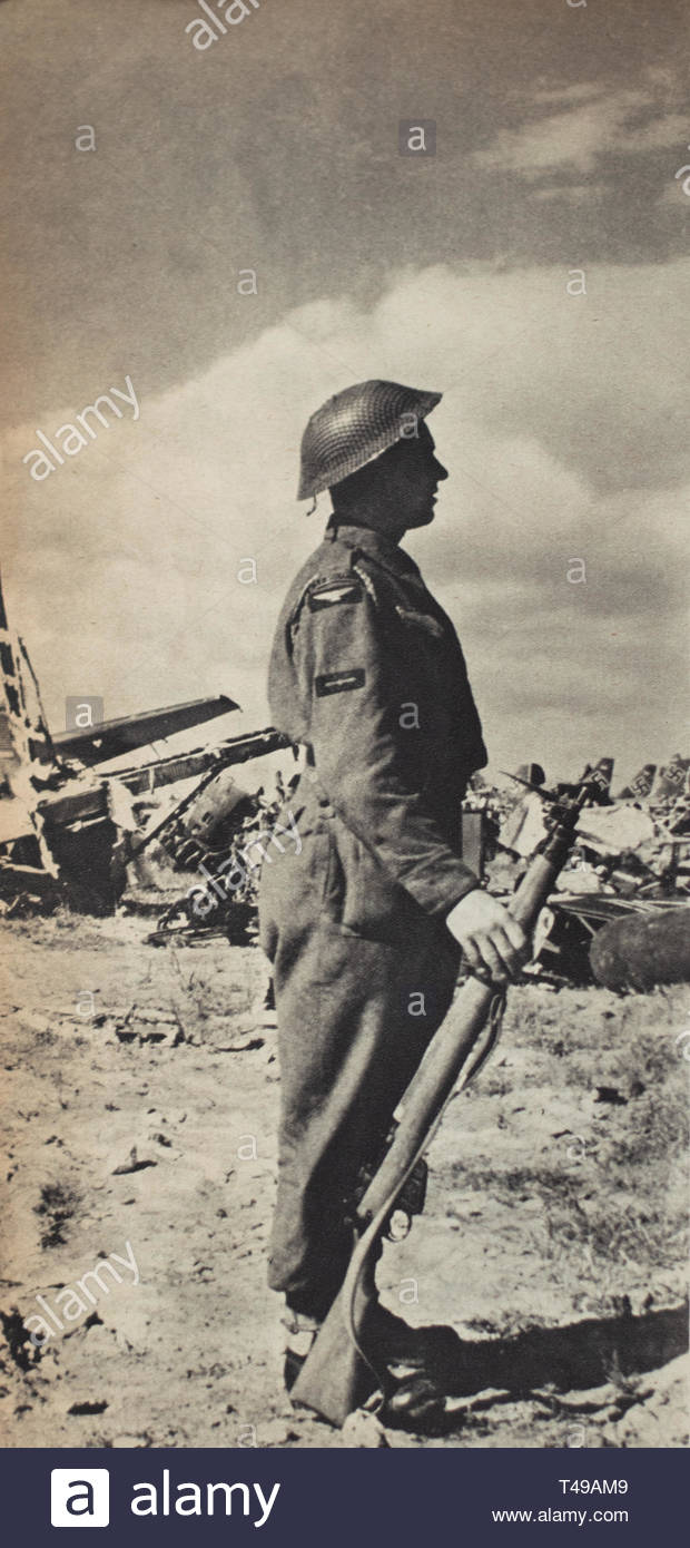 An RAF sentry stands on guard amid the wreckage of enemy aircraft on El Aouina airfield at Tunis. WW2, Tunisia, 1943. - Stock Image