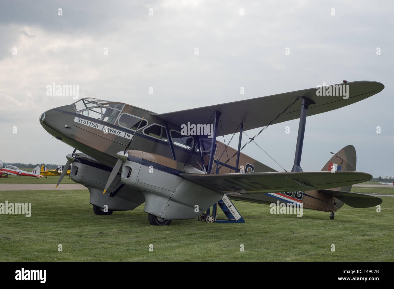 Ade Havilland Dragon Rapide painted in Scottish Airways livery at the Duxford Imperial War museum. A plane from the 1930s produced in Britain. - Stock Image