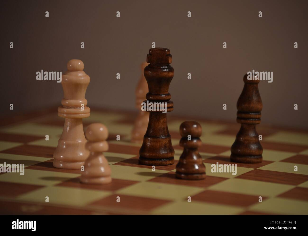 Chess board with figures, checkmate white wins - Stock Image