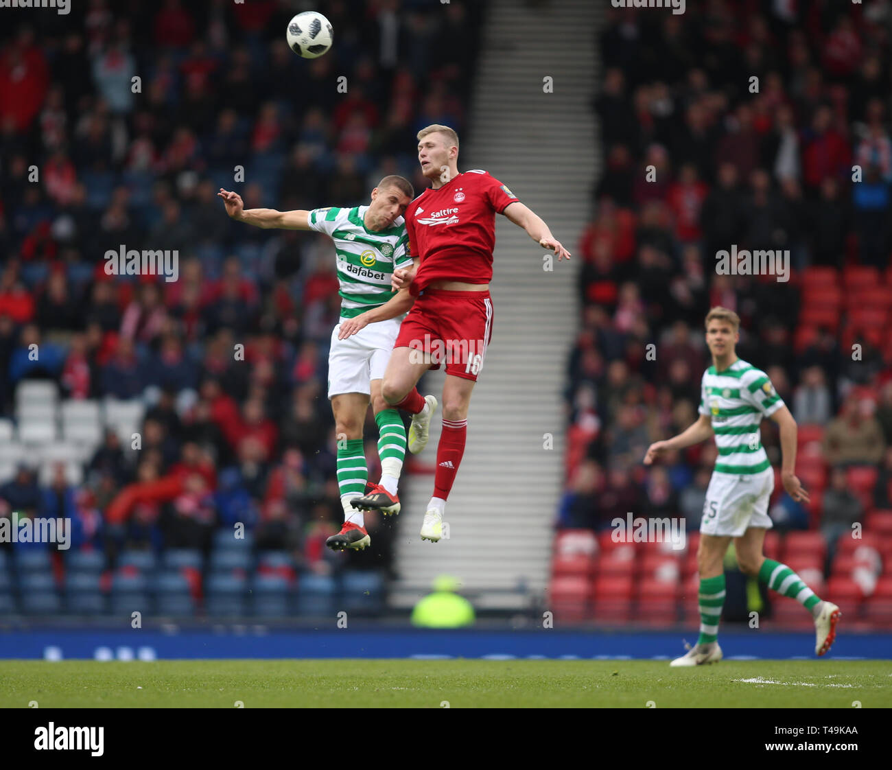 Hampden Park, Glasgow, UK. 14th Apr, 2019. Scottish Cup football, semi final, Aberdeen versus Celtic; Jozo Simunovic of Celtic and Sam Cosgrove of Aberdeen compete for the ball in the air Credit: Action Plus Sports/Alamy Live News - Stock Image