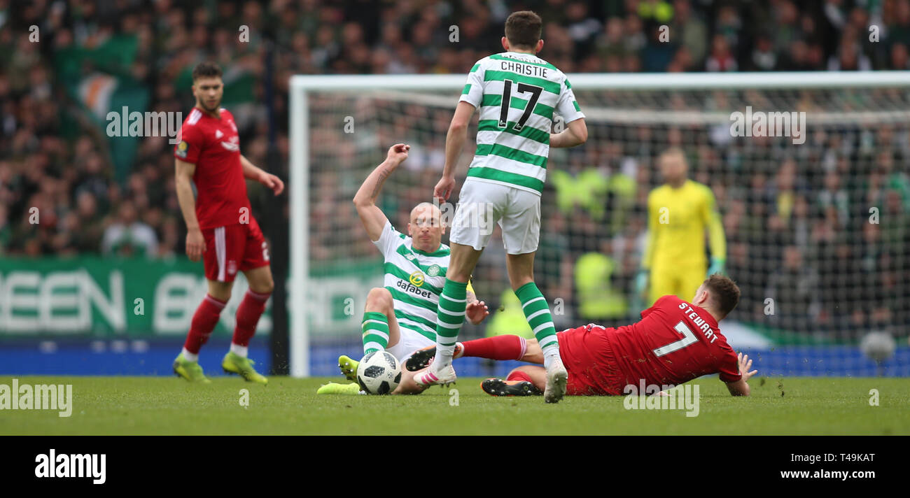 Hampden Park, Glasgow, UK. 14th Apr, 2019. Scottish Cup football, semi final, Aberdeen versus Celtic; Scott Brown of Celtic and Greg Stewart of Aberdeen slide in for the ball Credit: Action Plus Sports/Alamy Live News - Stock Image