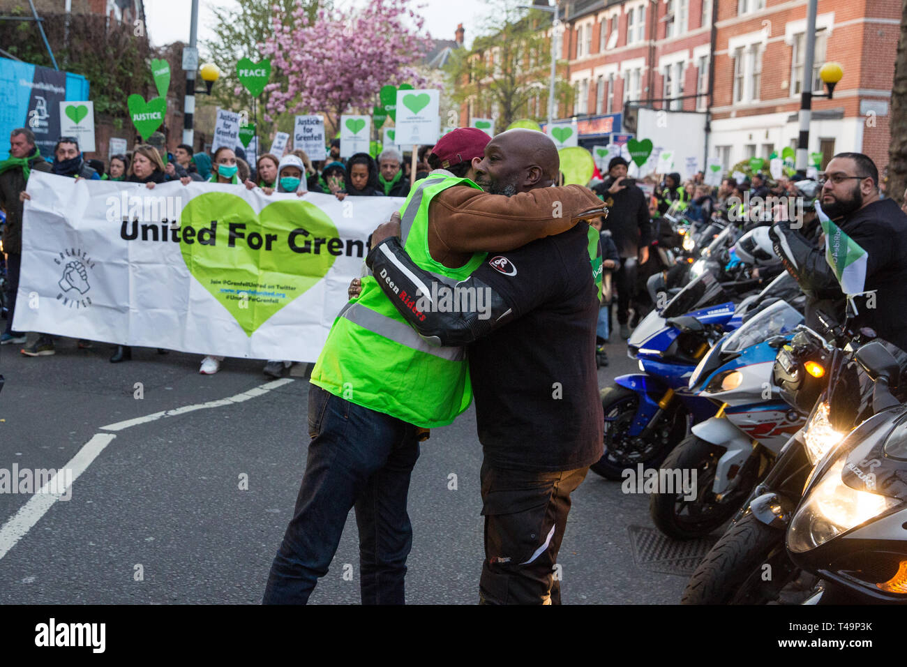 London, UK. 14th April 2019. Members of United Ride for Grenfell pay their respects to the Grenfell community and firefighters taking part in the Grenfell Silent Walk around North Kensington on the monthly anniversary of the fire on 14th June 2017. 72 people died in the Grenfell Tower fire and over 70 were injured. Credit: Mark Kerrison/Alamy Live News - Stock Image