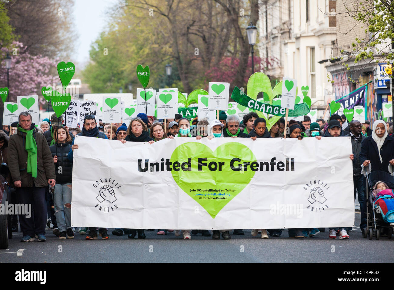 London, UK. 14th April 2019. Members of the Grenfell community and firefighters take part in the Grenfell Silent Walk around North Kensington on the monthly anniversary of the fire on 14th June 2017. 72 people died in the Grenfell Tower fire and over 70 were injured. Credit: Mark Kerrison/Alamy Live News - Stock Image