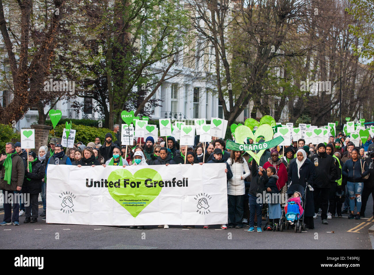 London, UK. 14th April 2019. Members of the Grenfell community and firefighters take part in the Grenfell Silent Walk around North Kensington on the monthly anniversary of the fire on 14th June 2017. 72 people died in the Grenfell Tower fire and over 70 were injured. Credit: Mark Kerrison/Alamy Live News Stock Photo