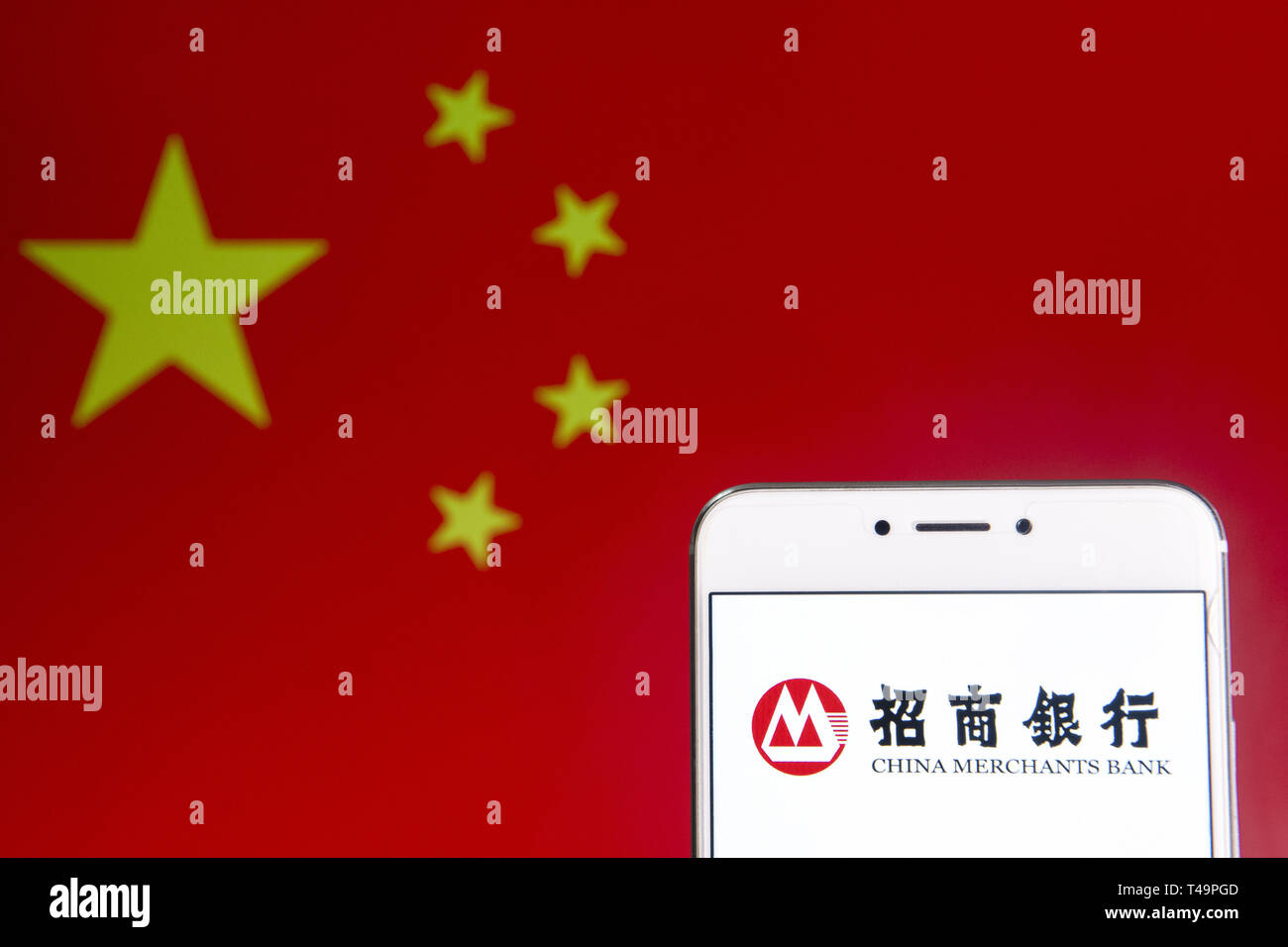 Hong Kong. 6th Apr, 2019. In this photo illustration a Chinese state-owned banking and financial corporation China Merchants Bank logo is seen on an Android mobile device with People's Republic of China flag in the background. Credit: Budrul Chukrut/SOPA Images/ZUMA Wire/Alamy Live News - Stock Image