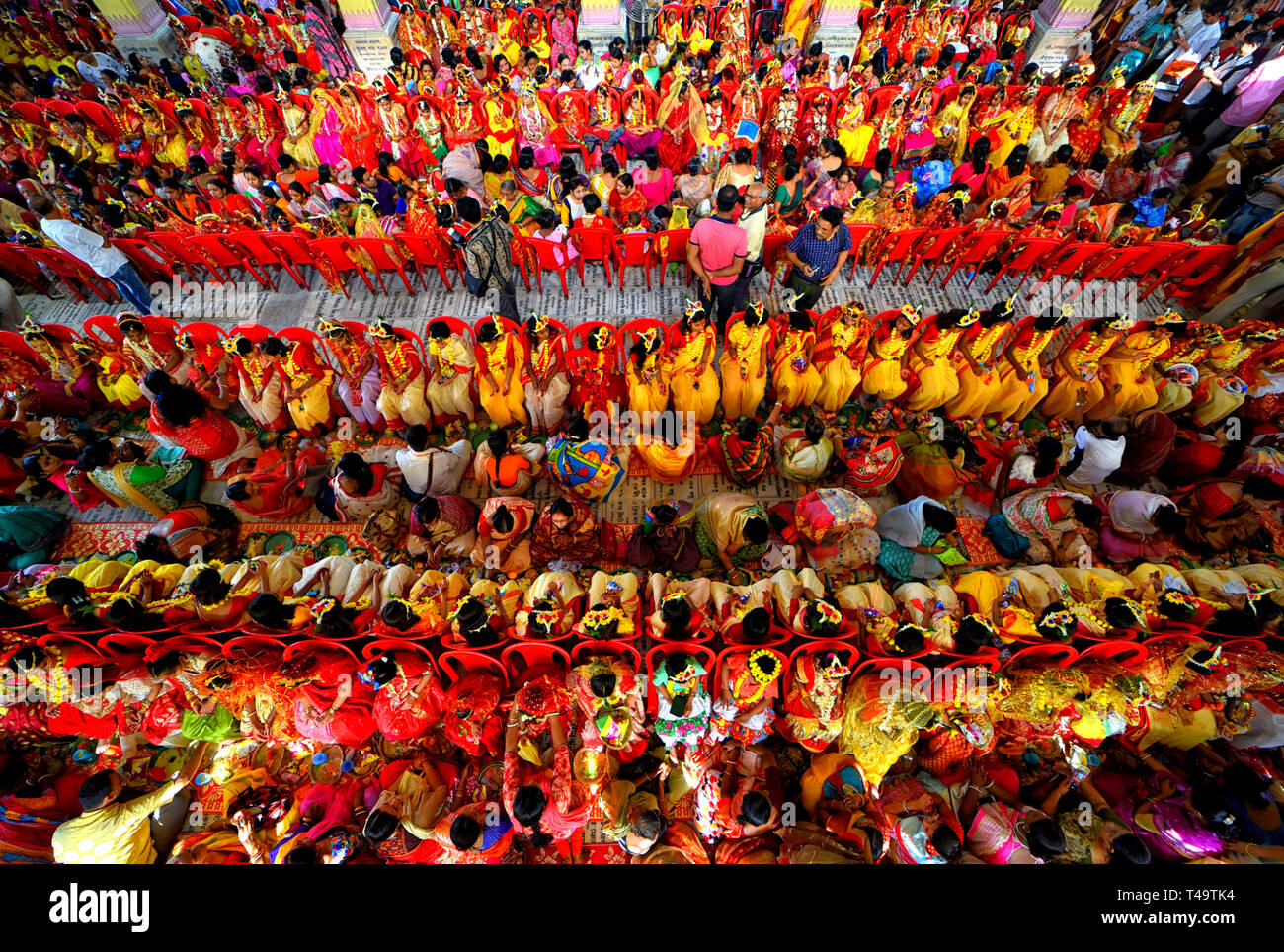 Kolkata, India. 14th Apr 2019. Aerial view of the inside adyapith Temple showing around 2000 young girls as they participate in Kumari Puja this year. Kumari Puja is an Indian Hindu Tradition mainly celebrated during the Durga Puja/Basanti Puja/Navratri according to Hindu calendar. Kumari actually describes a young virgin girl from the age 1 to 16 who is getting worshipped during the transition of Ashtami/Navami tithi of Durga Puja/Navaratri according to Hindu mythology. Credit: SOPA Images Limited/Alamy Live News - Stock Image