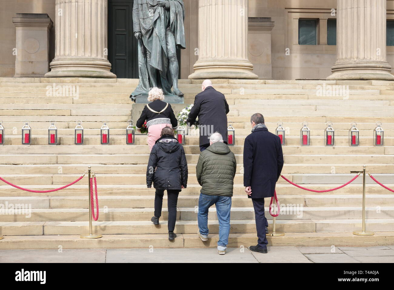Liverpool, UK. 15th Apr, 2019. Mayor Joe Anderson and Lord Mayor Councillor Christine Banks lay a wreath at the memorial service at St George's Hall to mark the 30th anniversary of the Hillsborough disaster in which 96 Liverpool supporters lost their lives. Credit: ken biggs/Alamy Live News - Stock Image