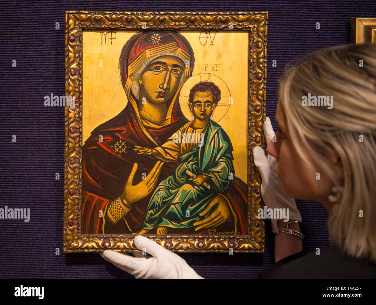 London, UK. 15th April, 2019. Bonhams Greek Art Sale preview takes place at New Bond Street Image: Nikos Engonopoulos. Vierge a l'Enfant. It is estimated at £5,000-7,000. The sale takes place on 17 April. Credit: Malcolm Park/Alamy Live News. - Stock Image