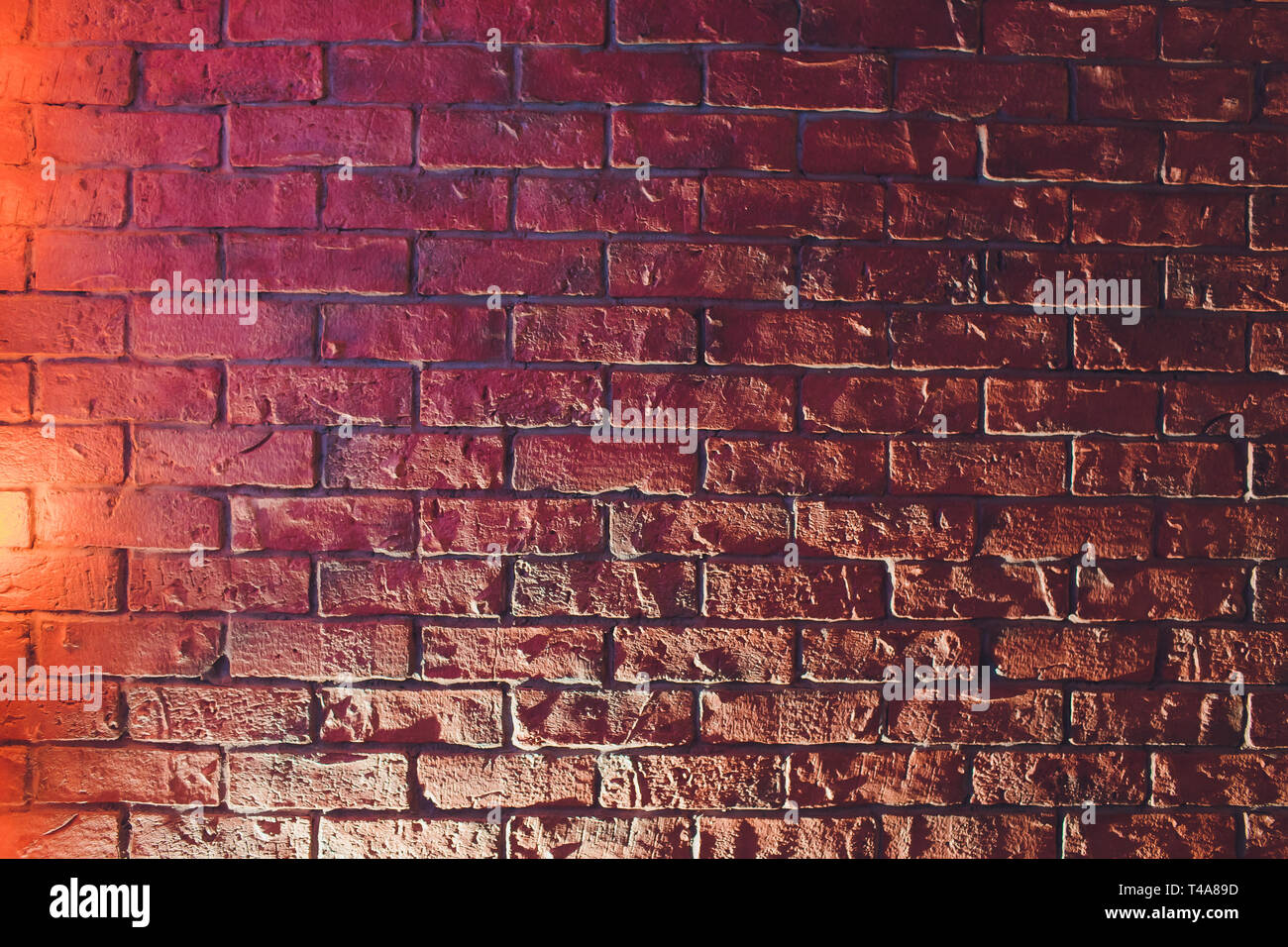 Brick wall, background, neon light Low key photo with lighting effect. - Stock Image