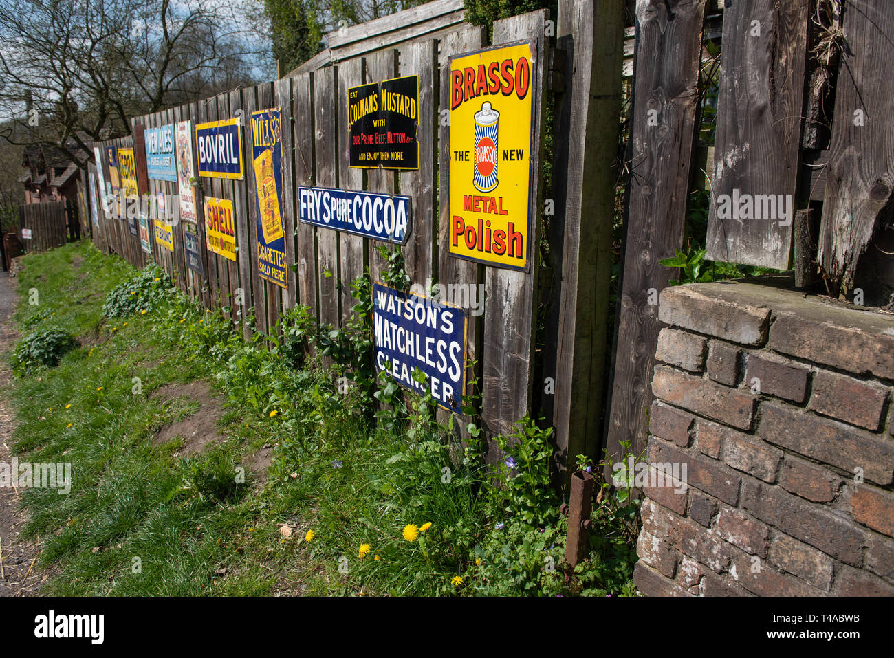Vintage Adverts on The High Street at Blists Hill Victorian Town Iron bridge - Stock Image