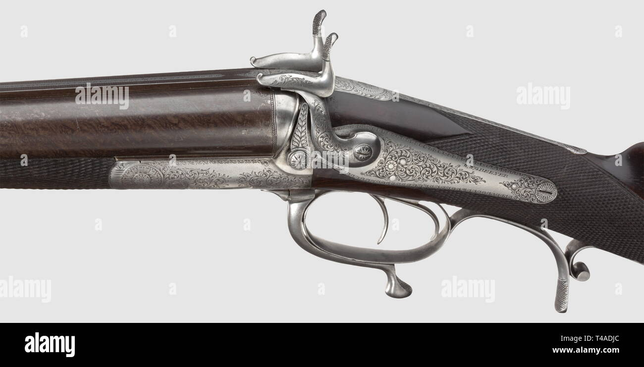 """A rare heavy double-barrelled pin-fire shotgun with paradox barrels, W. W. Greener, London, circa 1870/80. 17 mm calibre, no. 7112. Heavy Damascus barrels, the machined midrib with manufacturer's inscription """"W.W. Greener, No. 48 Duke St. St. James's & No. 11 Strand, London"""", one fixed and three folding rear sights. Mirror-like bores. The root of the barrel, the frame and the locks with high-quality chiselled foliage decoration. Repeated signature on the locks. The stock made from beautifully grained walnut wood with chequered small of the stock , Additional-Rights-Clearance-Info-Not-Available Stock Photo"""