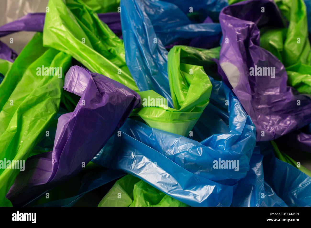 Intertwined bright bags lying as an example and reminder - Stock Image