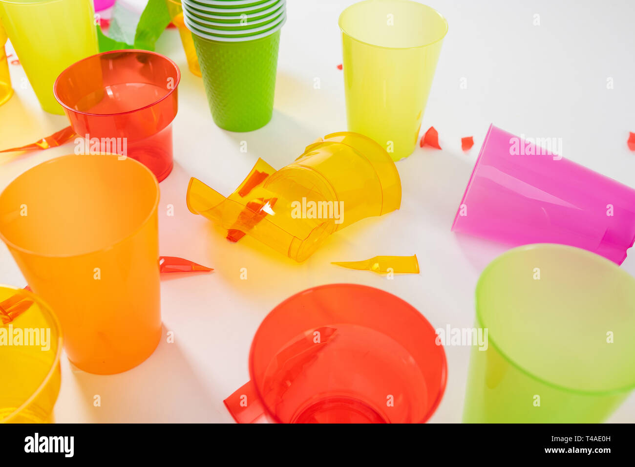 Broken plastic cups with sharp pieces standing together