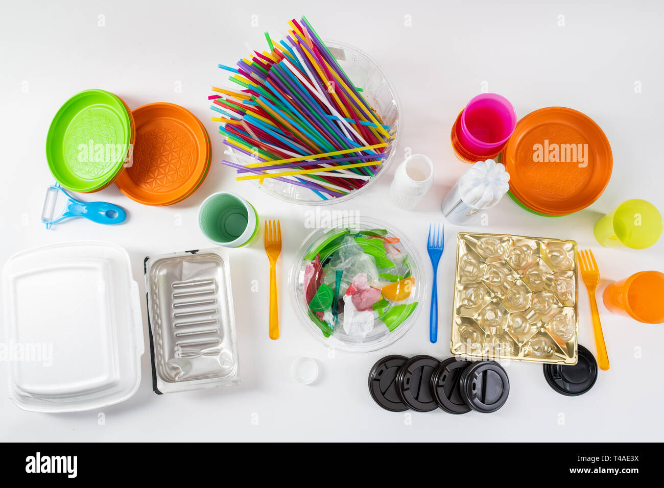 Colorful toxic stuff made of harmful plastic standing on white surface - Stock Image
