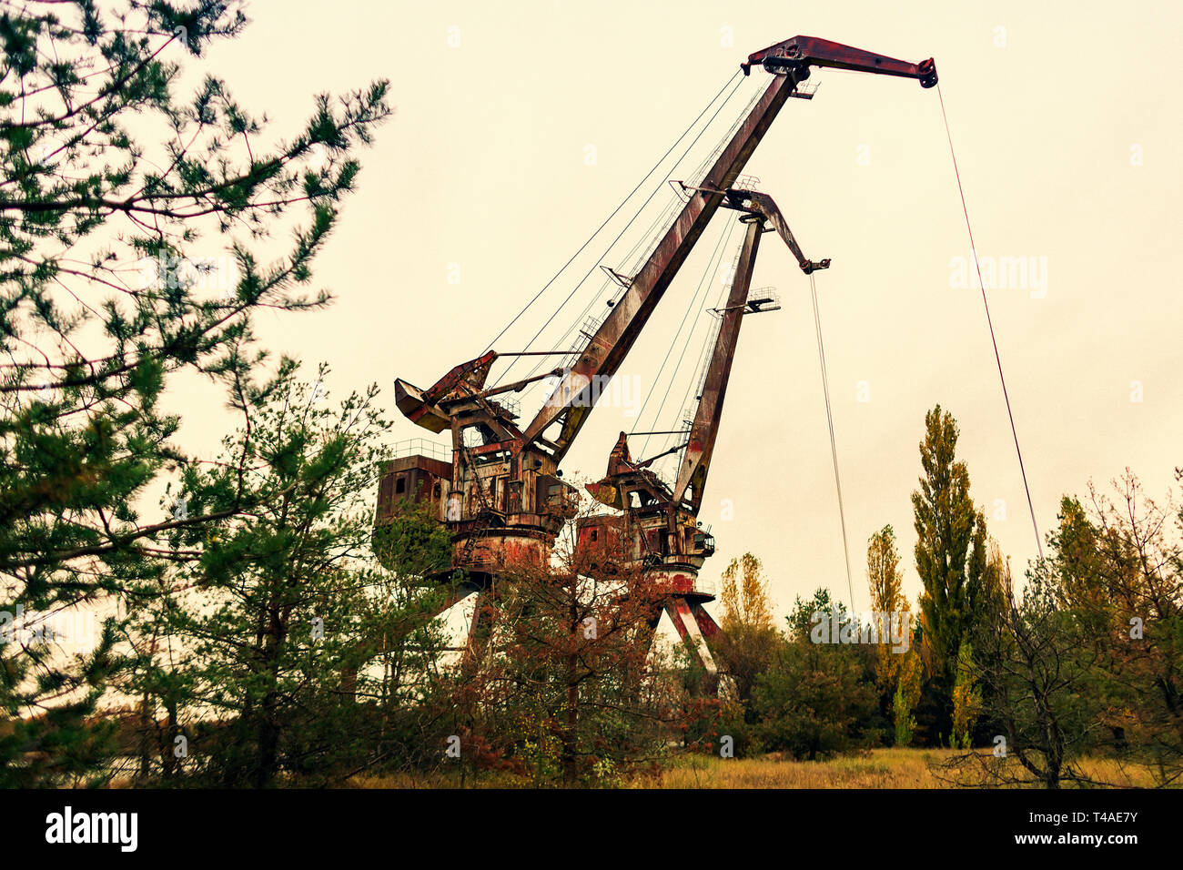 Abandoned cranes in harbour of Chernobyl in Ukraine nearby Chernobyl Nuclear Power Plant.  It was evacuated on the 27th of April 1986, day after the m - Stock Image