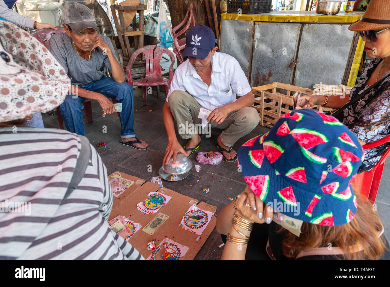 Street gambling den playing dice based betting and a homemade board, back streets, Old quarter, Hoi An, Quang NAm Provence, Vietnam, Asia - Stock Image