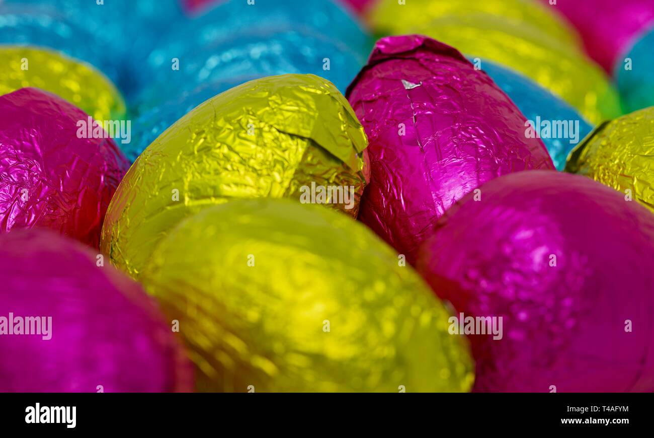Colourful collection of foil wrapped Easter Eggs - Stock Image