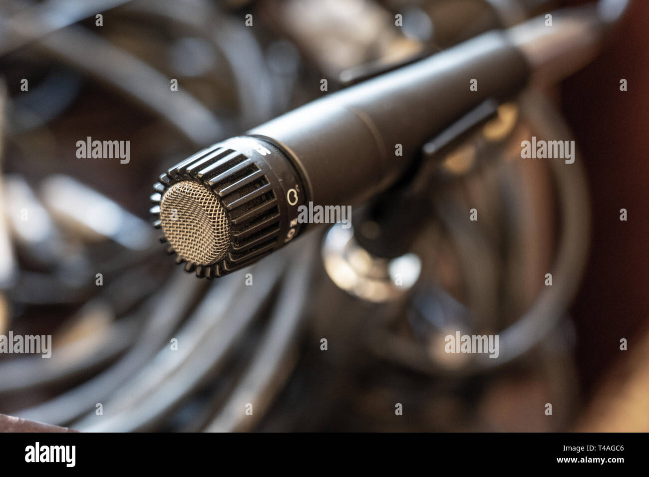 microphone with audio cables behind - Stock Image