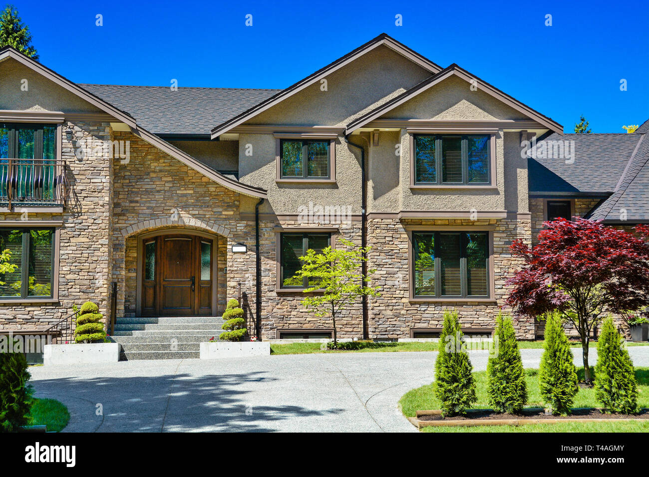 Luxury Family House With Concrete Driveway In Front On Blue Sky Background Stock Photo Alamy