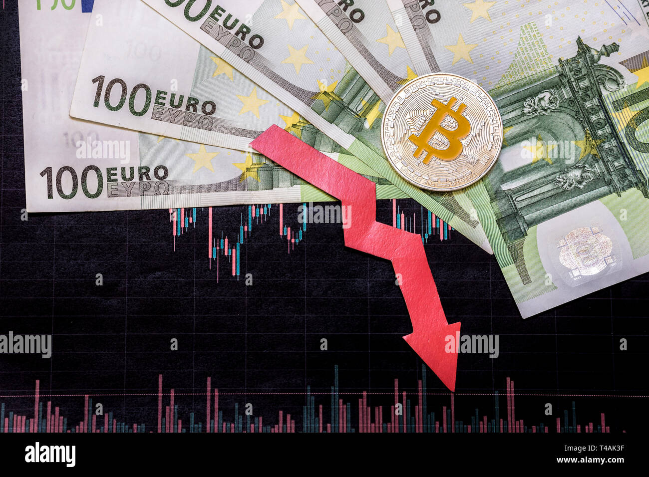 unprofitable investment of depreciation of virtual money bitcoin. Red arrow, silver bitcoin and euro go down on paper forex chart index background. Co - Stock Image