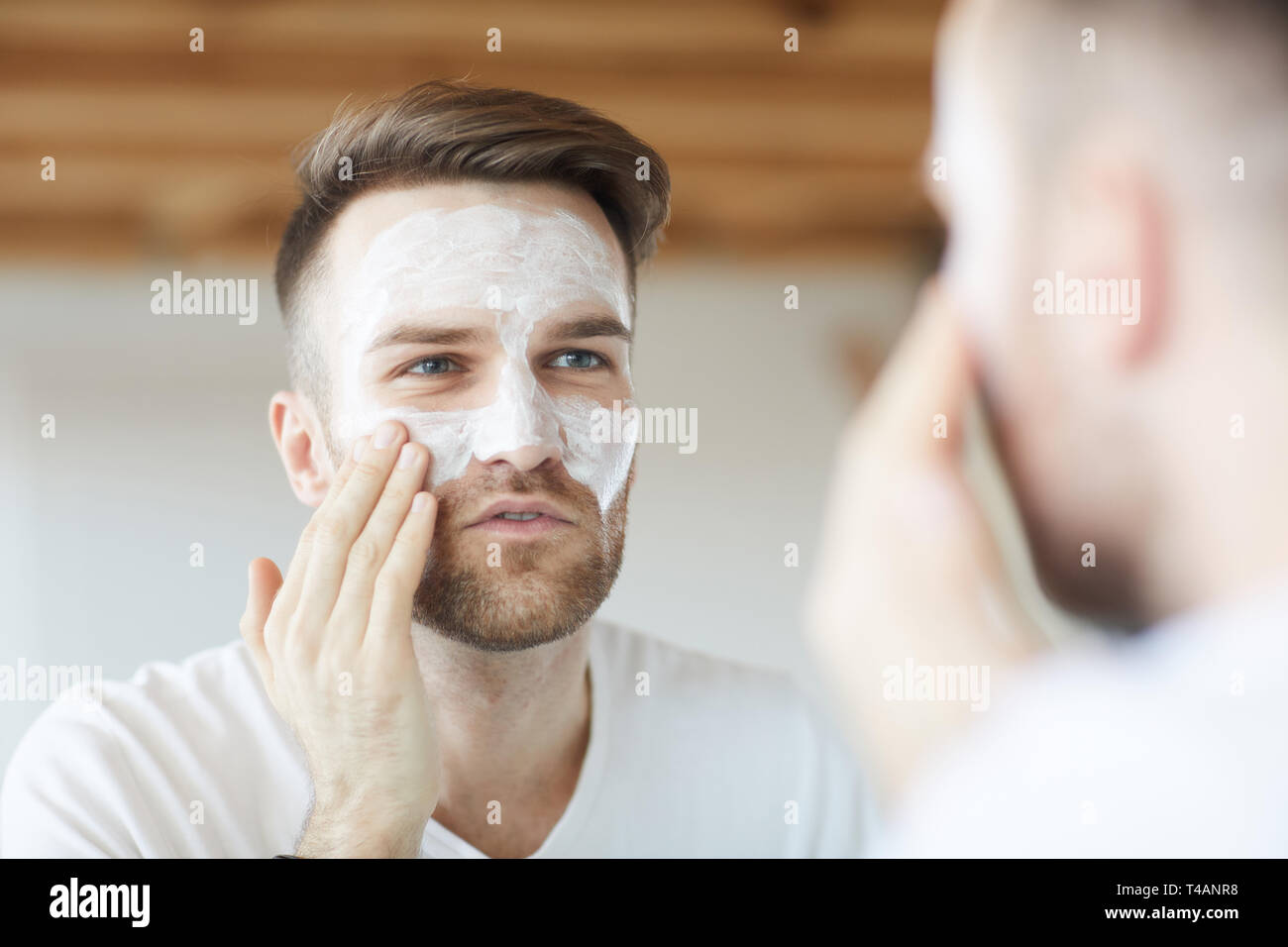 Man using Face Cream - Stock Image