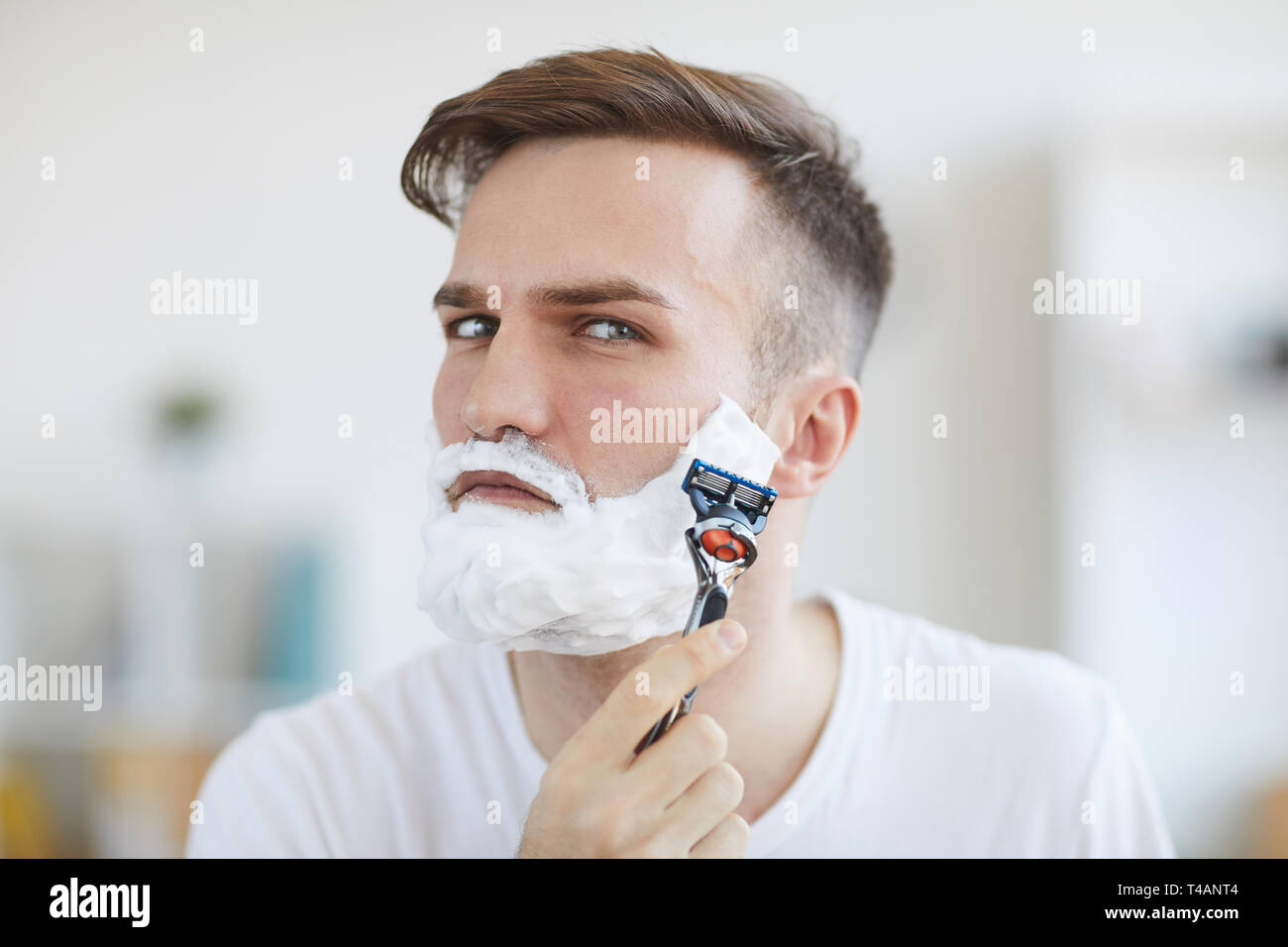 Young Man Shaving - Stock Image