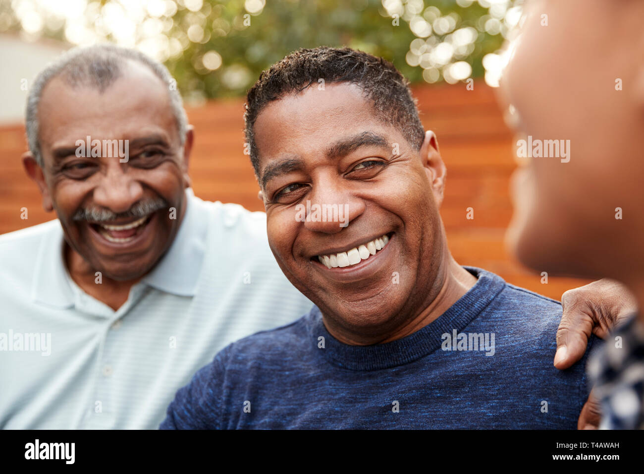 Three generations of family men laughing together, close up Stock Photo
