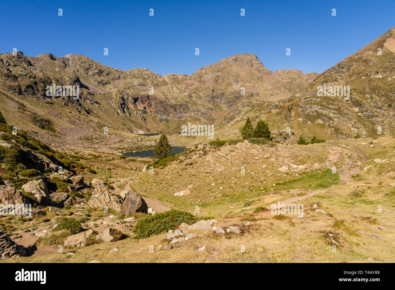 Wooden bridge in the hiking trail Estanys de Tristaina, Pyrenees, Andorra Stock Photo