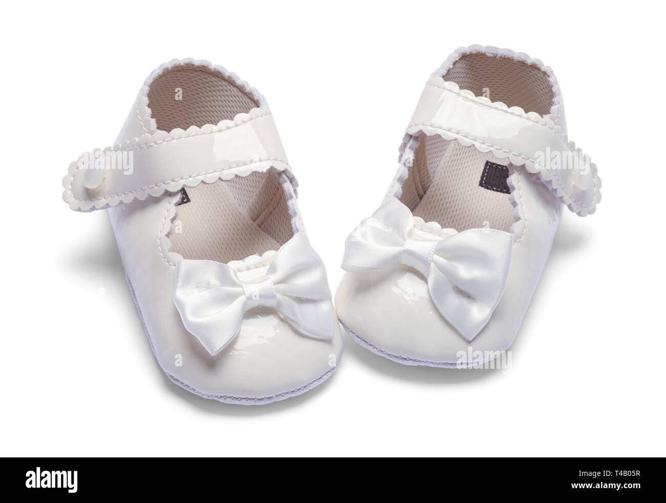 Girls Baby Dress Shoes Pointed Inward Isolated on White. - Stock Image