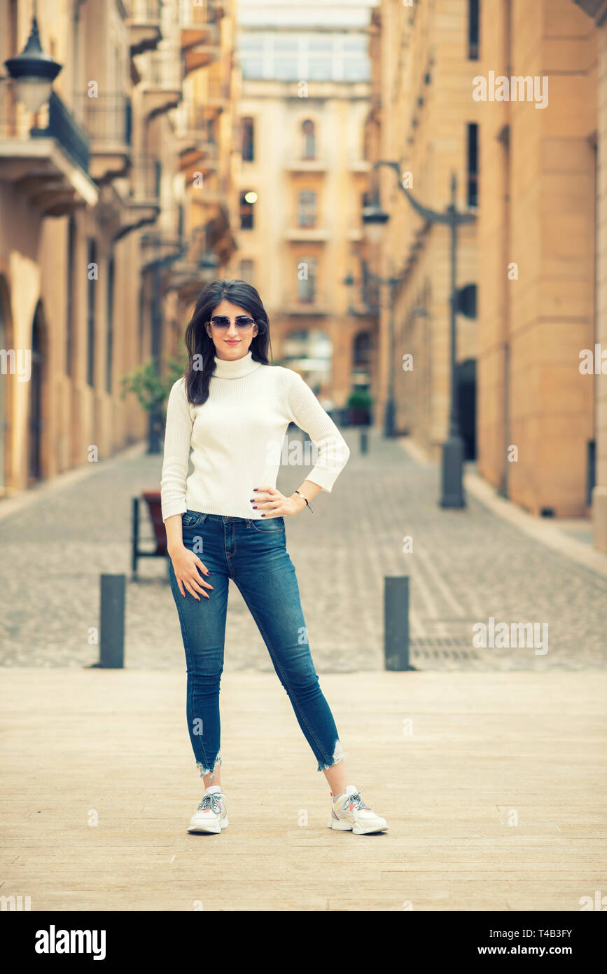Happy woman standing outdoors - Stock Image