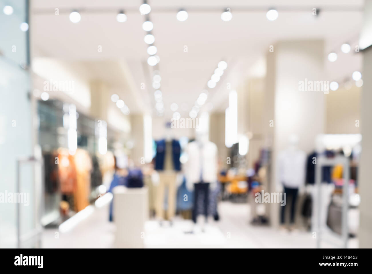 802da56cf8b Abstract blurred of fashion clothes shop boutique interior in shopping  mall, with bokeh light background