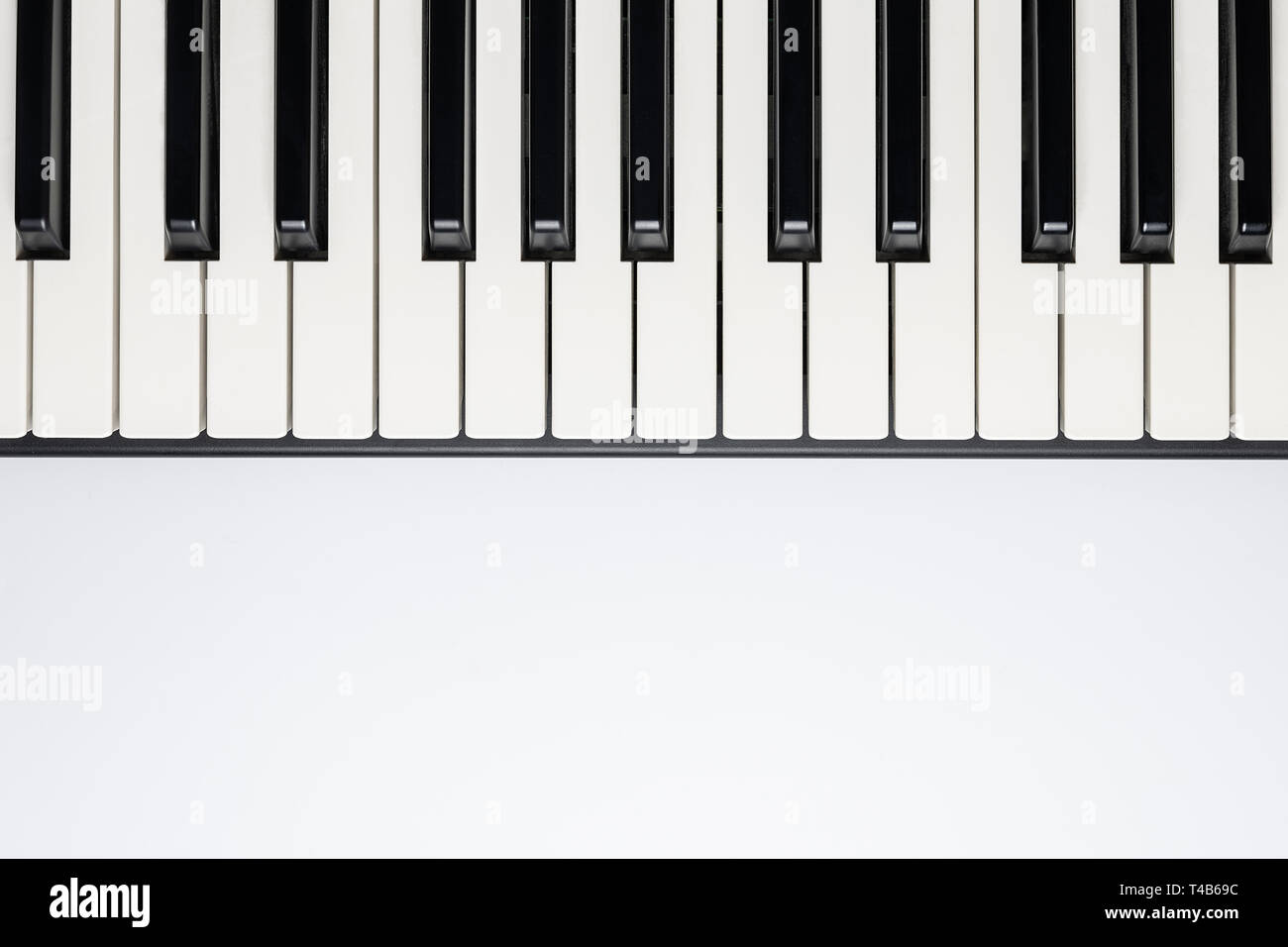 Piano keys with copy space, isolated for design, top view, flat lay. Piano or synthesizer keyboard. Classical music instrument for playing romantic mu - Stock Image