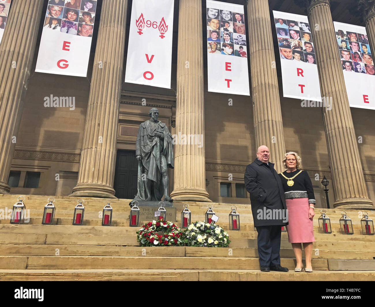 Mayor of Liverpool Joe Anderson and Lord Mayor Christine Banks stand on the steps of St George???s Hall in Liverpool after laying wreaths to mark the 30th anniversary of the Hillsborough disaster. - Stock Image