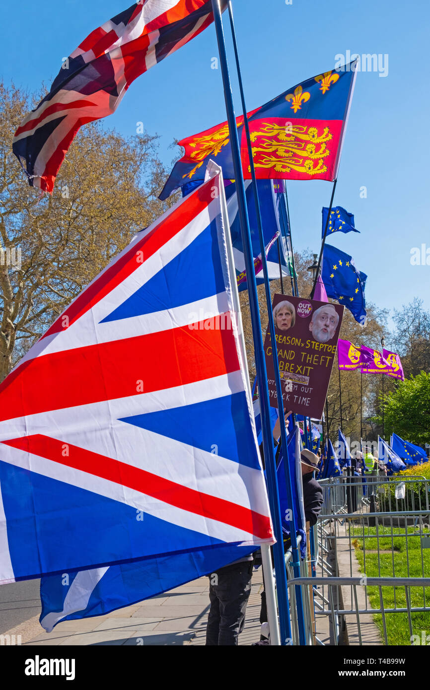 London, England – April 10, 2019: The flags of rival factions lining the pavement opposite the Houses of Parliament - Stock Image