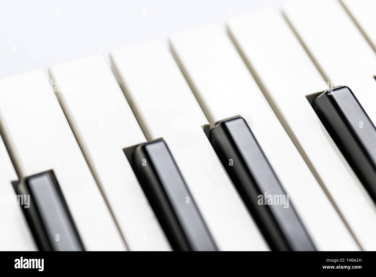 Piano keys close up view. Classical music instrument for playing or composing romantic music. Piano or synthesizer keyboard. - Stock Image