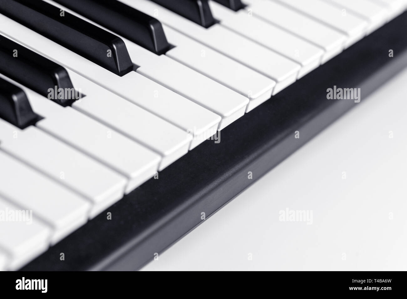 Piano keys with copy space, isolated. Piano or synthesizer keyboard. Classical music instrument for playing or composing romantic music. - Stock Image