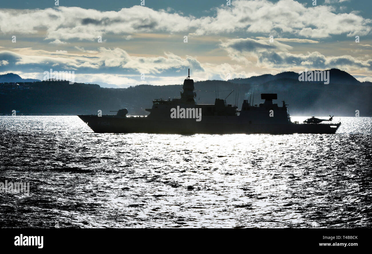 The Dutch warship HNLMS De Ruyter in Norwegian waters with embarked NH90 helicopter Stock Photo