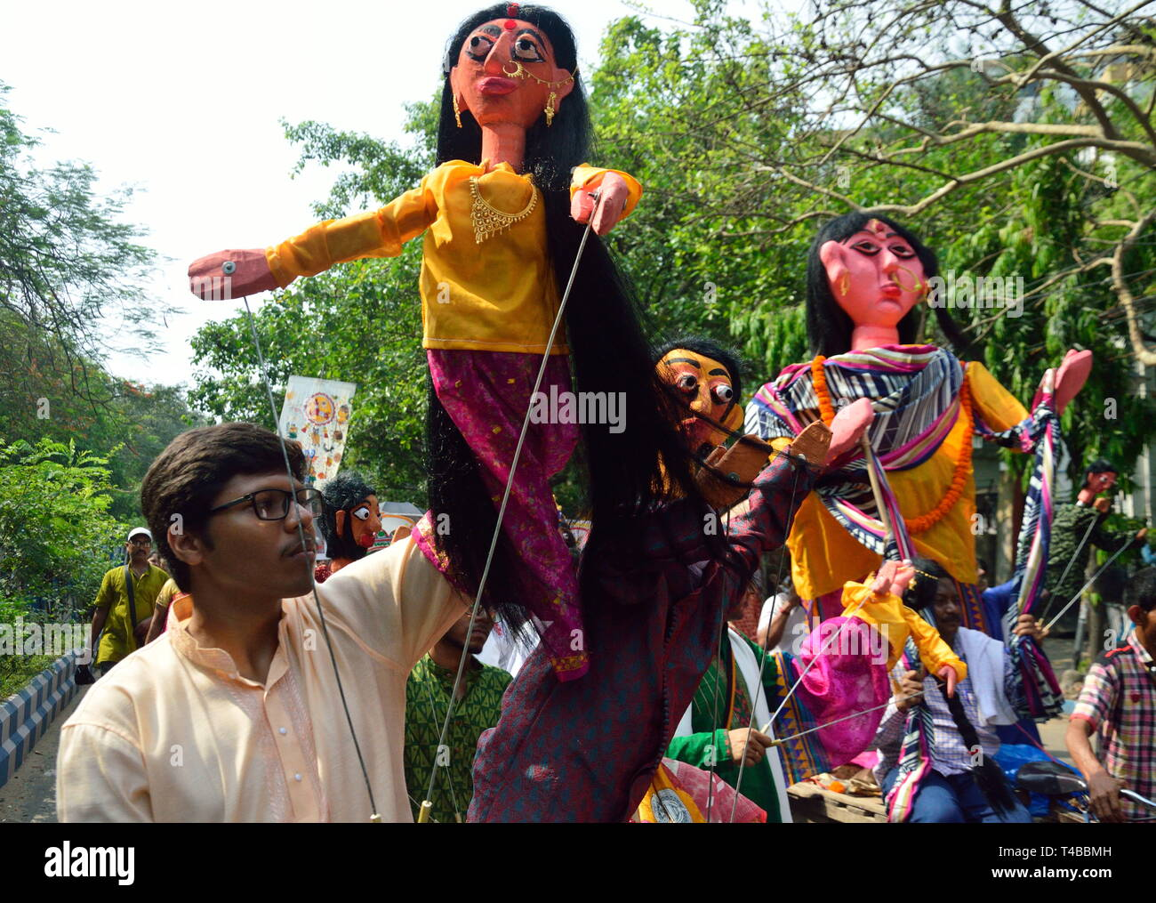 Kolkata, India. 15th Apr, 2019. Bengali new year celebrated in Kolkata. People celebrate this day with music, dance, wearing new clothes, and many of them take part of the road rally with masks, placards and songs. Credit: Suvrajit Dutta/Pacific Press/Alamy Live News - Stock Image