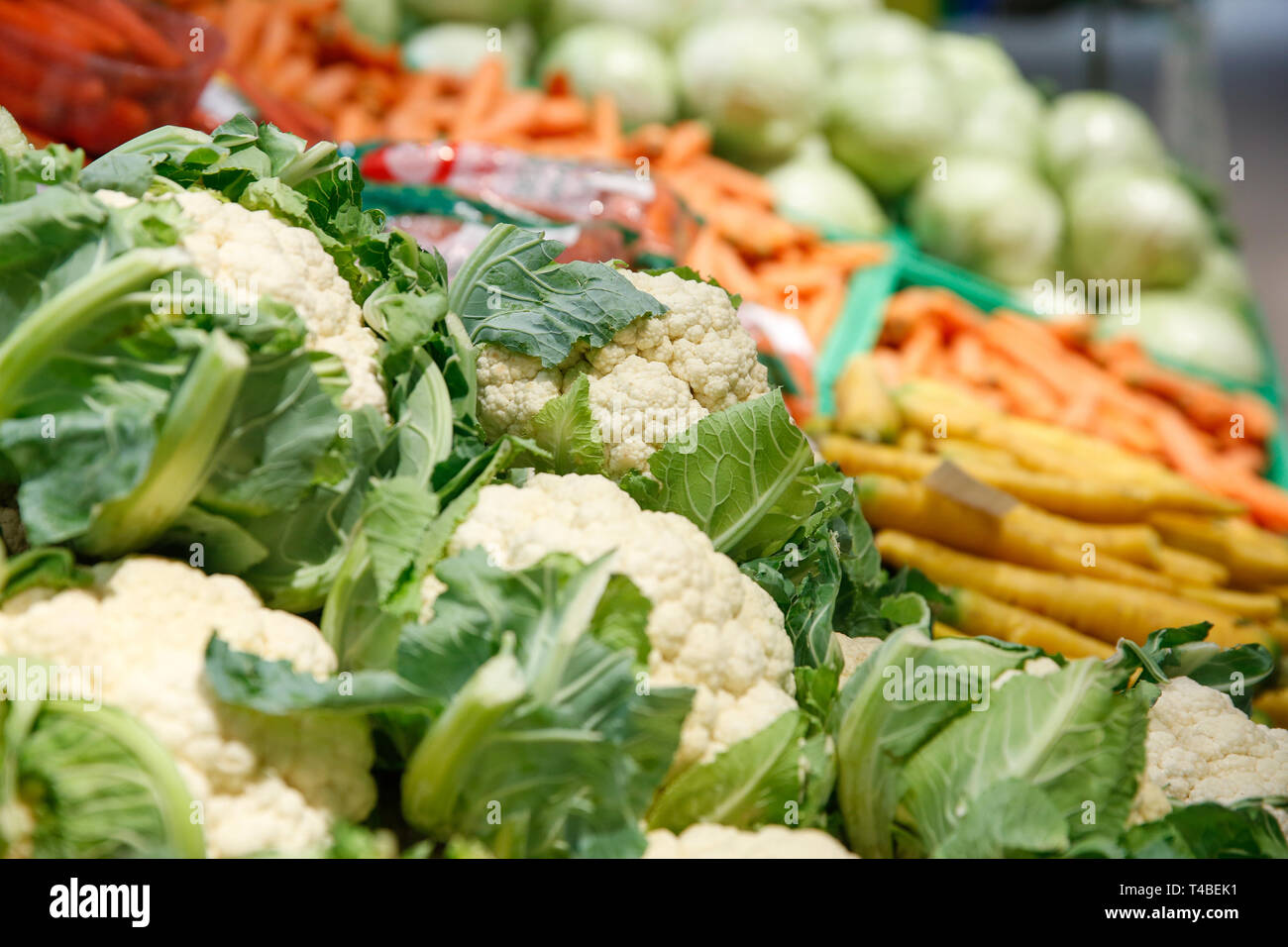 Unpacked, fresh vegetables in a self-service supermarket. Zero-waste movement and philosophy, sustainable trade and organic grocery concept. - Stock Image