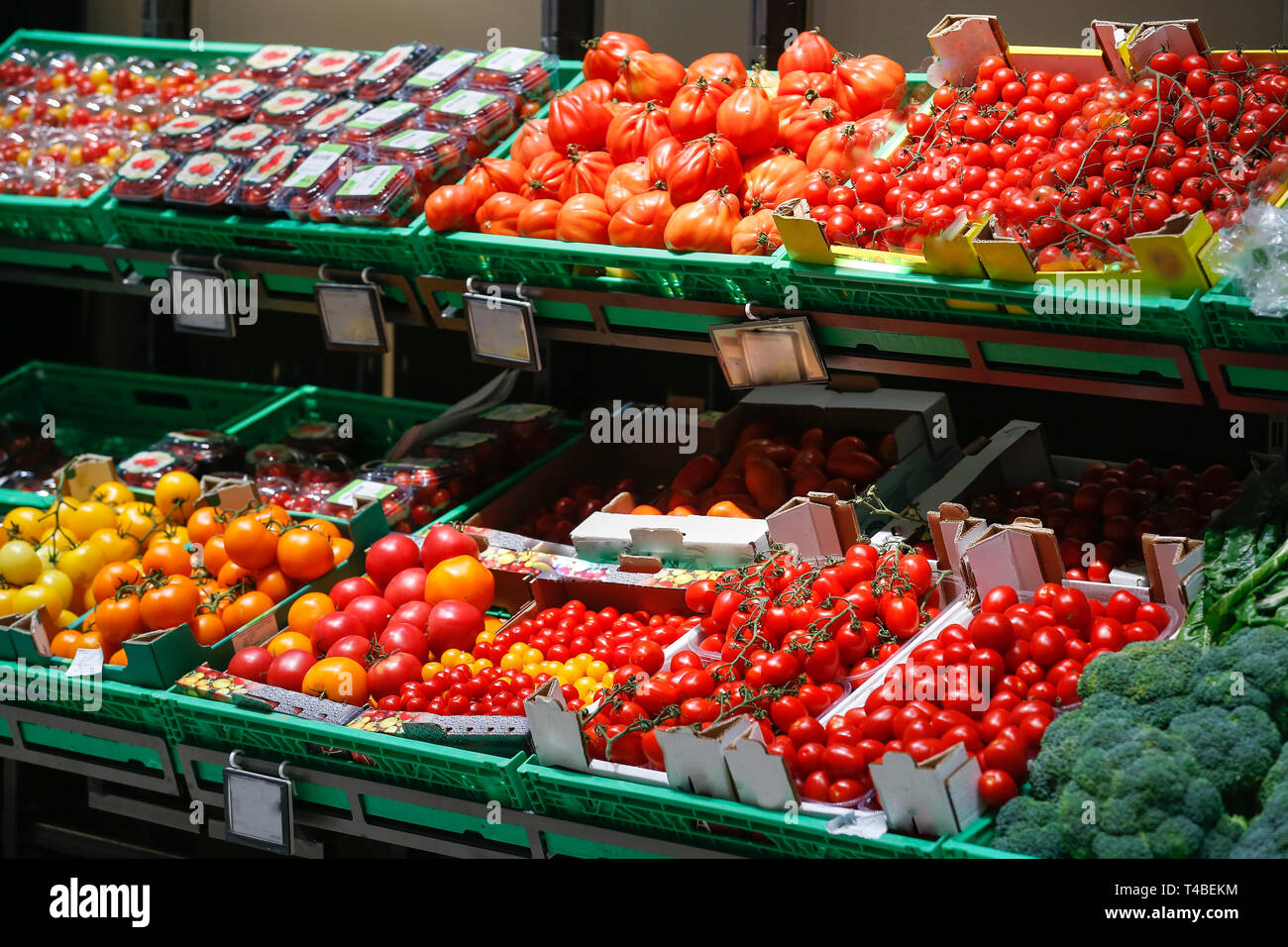 Unpacked, fresh assortment of tomatoes in a self-service supermarket. Zero-waste movement and philosophy, sustainable trade and organic grocery concep - Stock Image