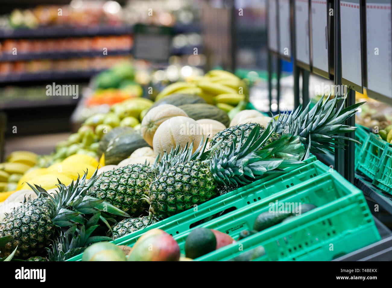 Unpacked, fresh exotic fruits in a self-service supermarket. Zero-waste movement and philosophy, sustainable trade and organic grocery concept. - Stock Image