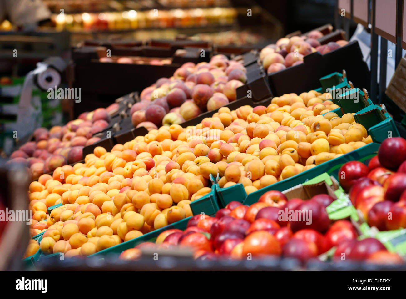 Unpacked, fresh fruits in a self-service supermarket. Zero-waste movement and philosophy, sustainable trade and organic grocery concept. - Stock Image