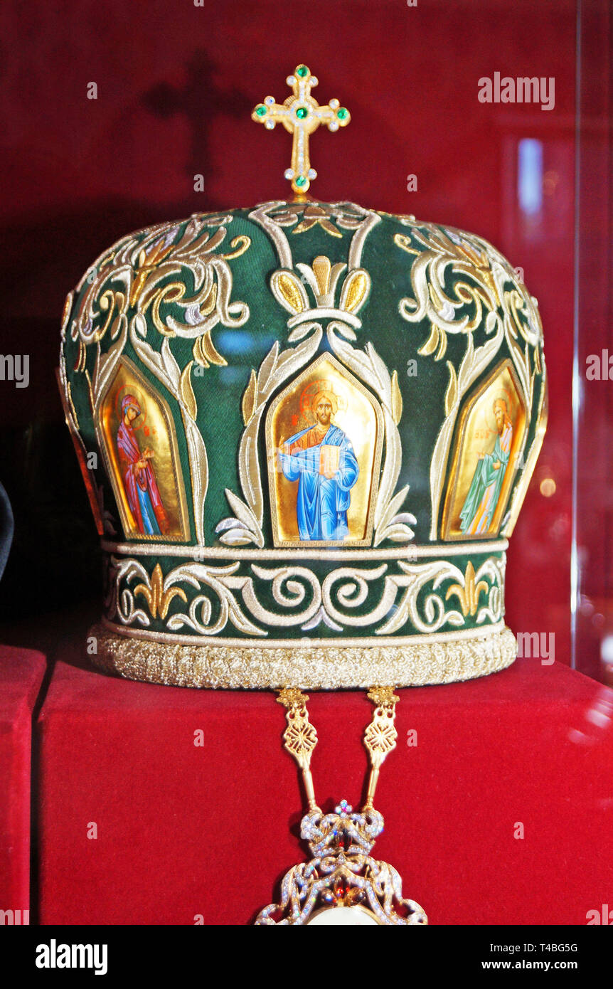 The headdress of the priest decorated with icons and a cross inlaid with gold, silver and precious stones - Stock Image