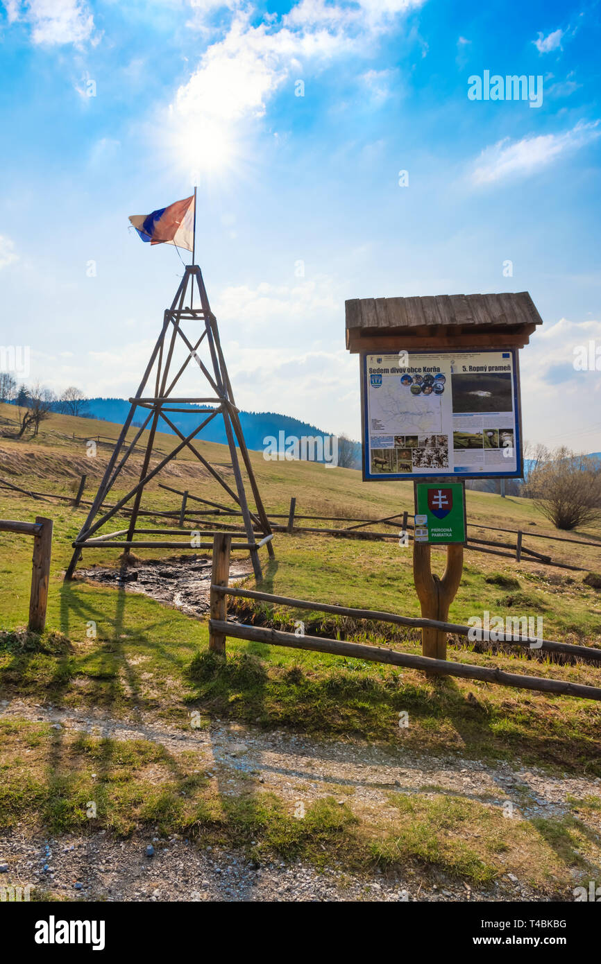 "KORNA, SLOVAKIA – APRIL 8 2019:  View of the oil seepage and its drainage trench in Korna village in protected natural area of Kysuce. Translation: ""S Stock Photo"