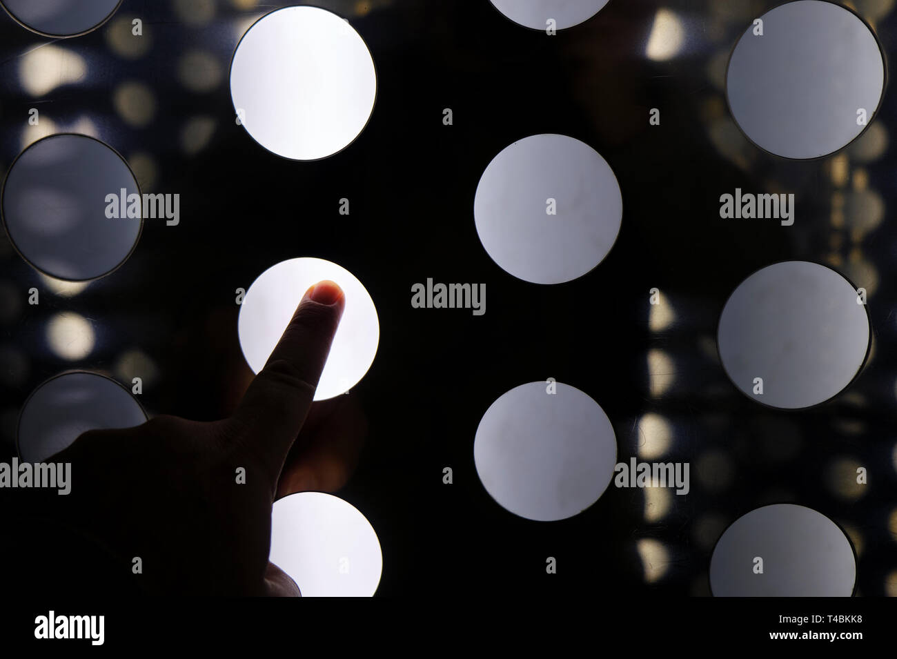 finger tapping on abstract interface digital wall - virtual room experience - Stock Image