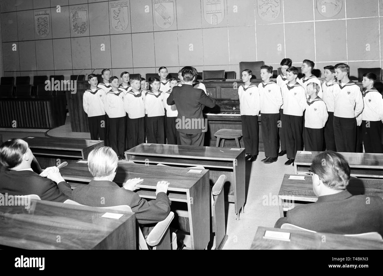 The Vienna Boys' Choir, which is on a tour through Germany, serenades for former German chancellor Konrad Adenauer (sitting, M, back) on the 12th of February in 1963 in Bonn. | usage worldwide - Stock Image