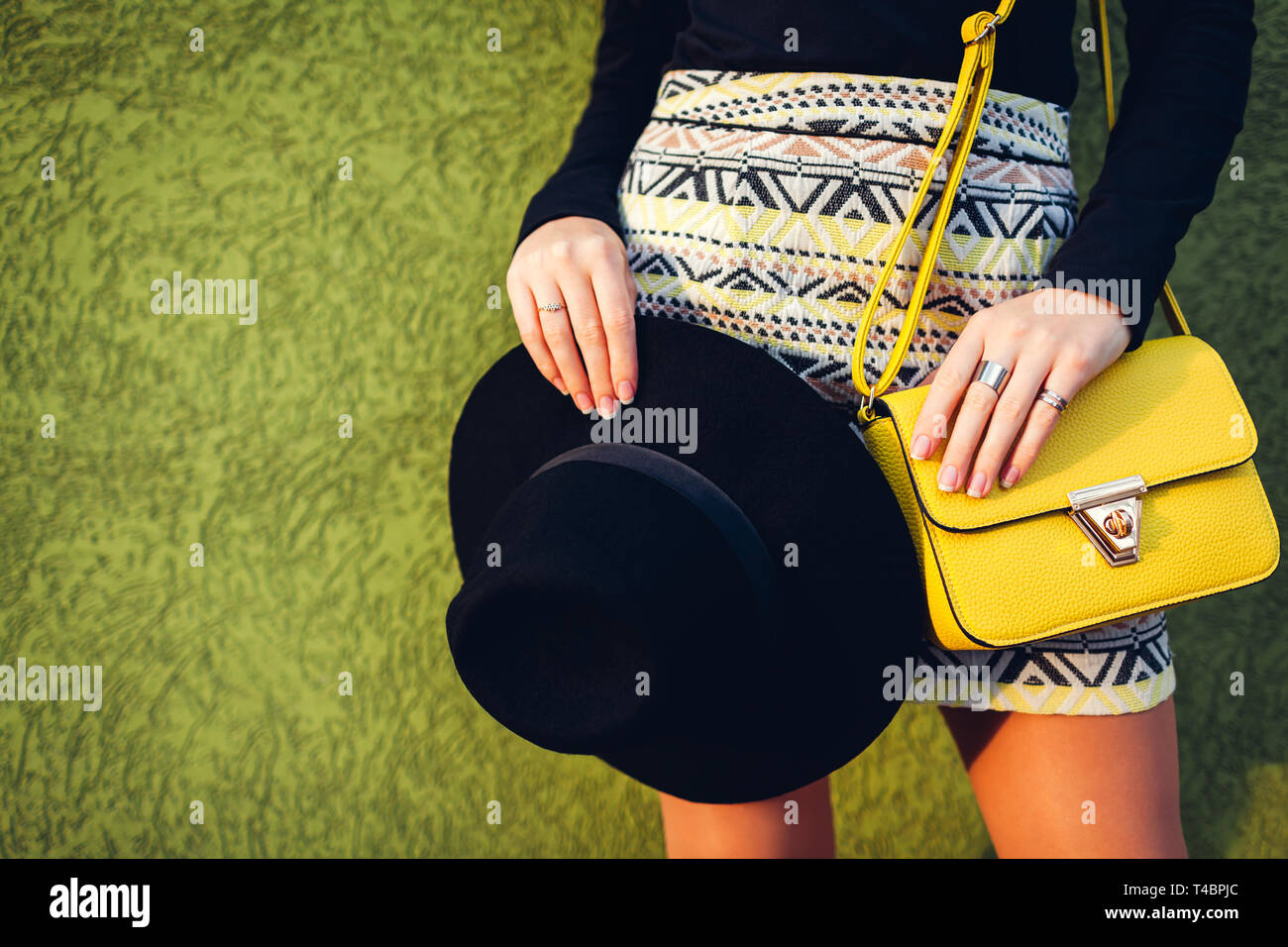 aebdf17d Young stylish woman wearing beautiful outfit with handbag and hat. Spring female  clothes and accessories. Fashion concept